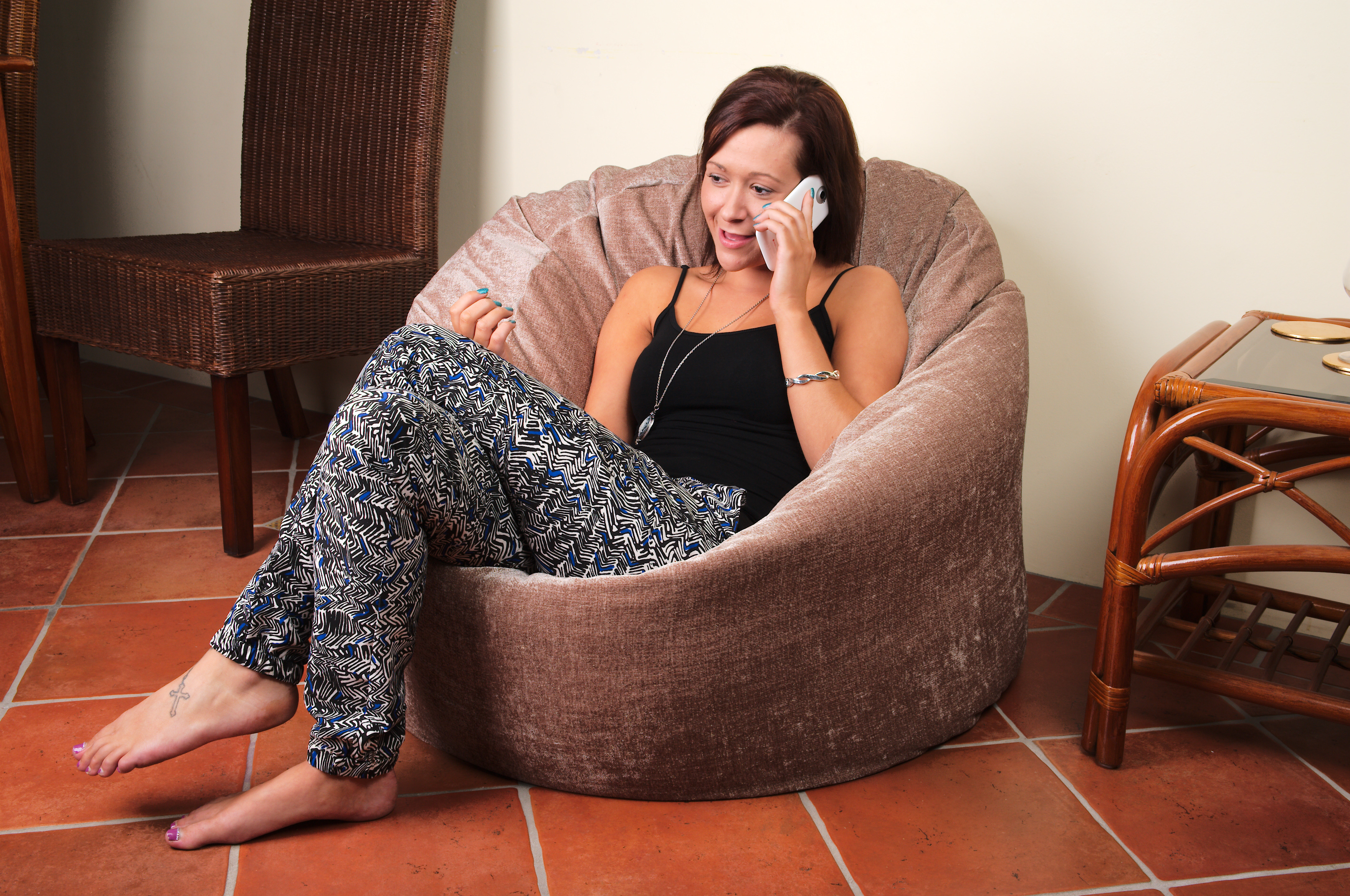 Girl sitting on beanbag using phone